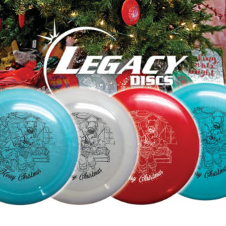 Legacy Christmas discs - 4 discs pictured with a Christmas scene in the back