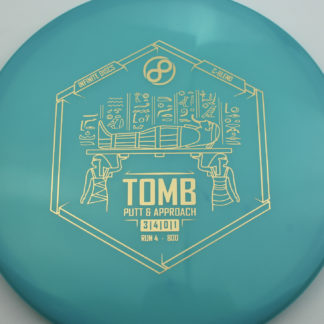 Infinite Diss Tomb in teal plastic with a gold stamp.